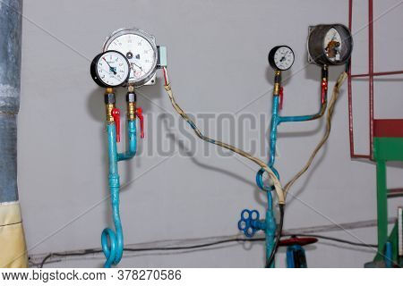 Manometers. Outdated Temperature And Pressure Sensors On The Hot Water Pipe In The Old Pumping Stati