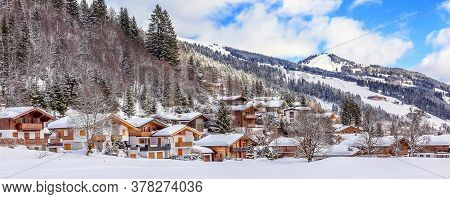 Winter Snow Mountain Village Panorama Banner With Wooden Traditional Houses In Austrian Alps, Austri