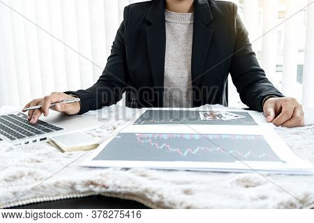 The Girl's Hand Is A Stockbroker Who Holds Cards And Plans A Business Investment By Analyzing And Ca