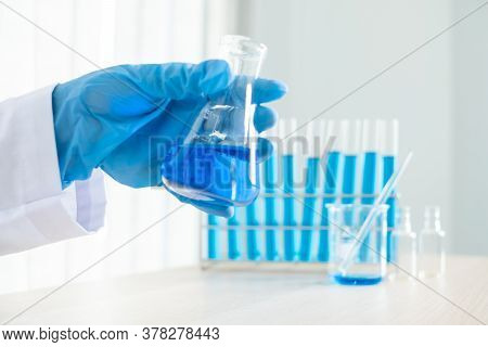 Medical Scientists Released A Sample Pipetted Into A Test Flask To Analyze The Virus In A Chemical L