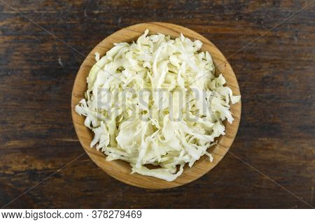 Chopped Cabbage In A Bowl On A Wooden Background. Vegetable, Ingredient And Staple Food. Healthy Foo