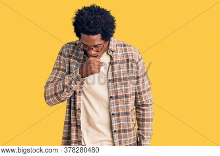 Handsome african american man with afro hair wearing casual clothes and glasses feeling unwell and coughing as symptom for cold or bronchitis. health care concept.