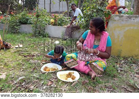 KUMROKHALI, INDIA - FEBRUARY 23, 2020: A family having lunch in Kumrokhali village, West Bengal, India