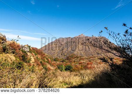 Picturesque Autumn View Of Unzen Nita Pass Trail With Rocky Volcano Peak, Clear Blue Sky And Colorfu