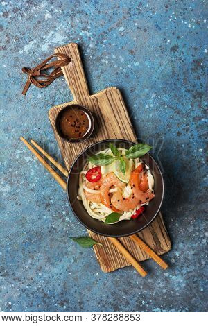 A Traditional Dish Of Asian Cuisine. Udon Noodles With Shrimps, Spicy Sauce And Chopstick