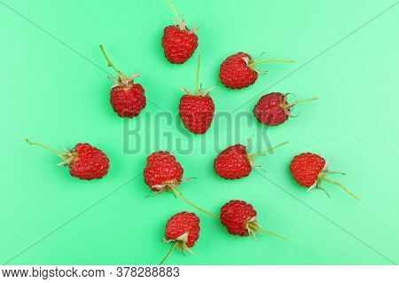 Ripe Red Raspberries Isolated On A Green Background. Healthy Organic Food. Harvest,