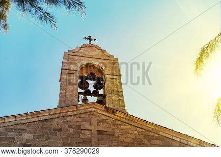 Steeple On Top Of The Roof Of Christian Orthodox Byzantine Greek Church. Big Bronze Bell, And A Big