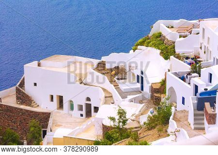 Oia, Santorini, Greece Famous Village In Cyclades Island With White Houses