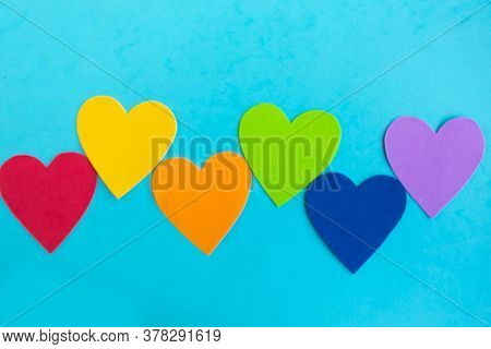 Hearts In Lgbtq Colors On Blue Background, Top View