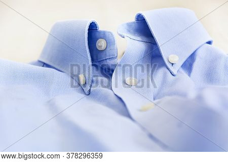 A Light Blue Shirt With A Button Down Collar. Formal Wear For Events Or Work And Business Meetings