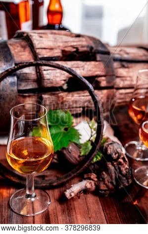 Tasting Glasses With Aged French Cognac Brandy In Old Cellars Of Cognac-producing Regions Champagne