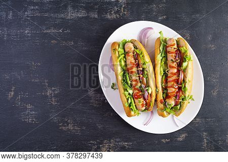 Homemade Hot Dog With Sausage, Salad, Carrot, Cucumber And Tomato On Wooden Background