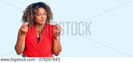 Young african american plus size woman wearing casual style with sleeveless shirt doing money gesture with hands, asking for salary payment, millionaire business