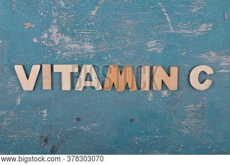 Colorful And Crisp Image Of Term From Wooden Letters On Weathered Concrete