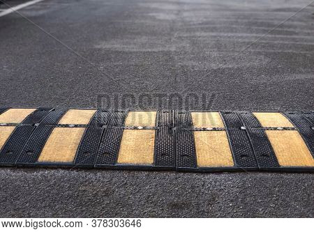Speed Bump Close-up In The City. Road Safete Object. City Infrastructure