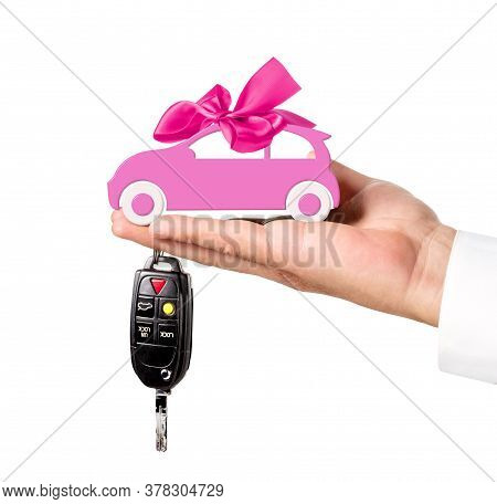 Car With Bow And Key On Dealers Hand Isolated On White Background. Car Purchase Concept