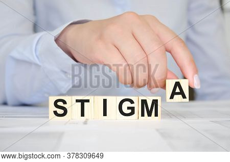 Woman Holds A Cube With Text. Written Text Stigma
