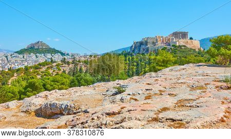 Panorama of Athens city with Lycabettus and Acropolis hills from Hill of the Nymphs, Greece. Greek landscape