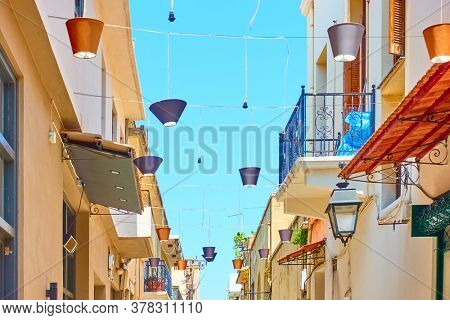 Street in Rethymno decorated with lampshades, Crete, Greece