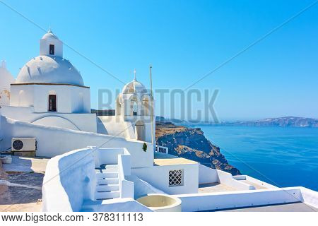 View with greek orthodox church in Fira town in Santorini island, Greece.  Greek scenery