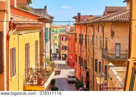 Picturesque street in Santarcangelo di Romagna town on summer sunny day, Rinini Province, Italy. Italian cityscape