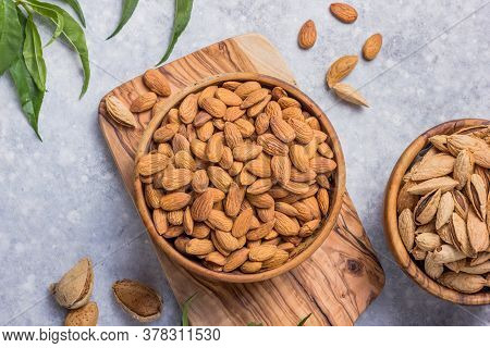 Peeled Whole Almonds And Unshelled Almonds In Bowl With Leaf. Peeled, Unshelled Whole Almonds And Al