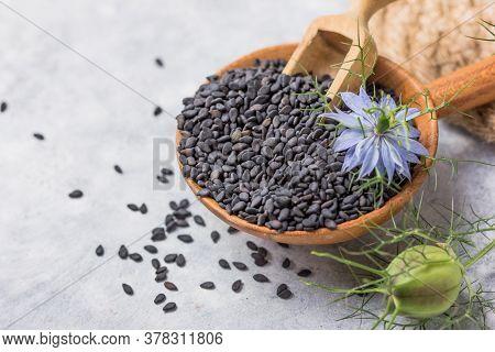 Black Cumin Seeds With Nigella Sativa Flower On White Background.  Black Sesame