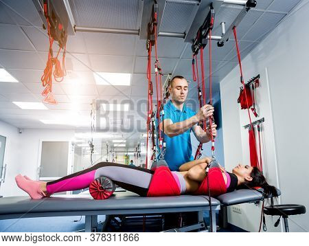Physiotherapy. Suspension Training Therapy. Young Woman Doing Fitness Therapy.