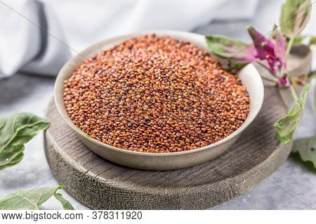 Raw Red Quinoa Seeds (lat. Chenopodium Quinoa) On Plate