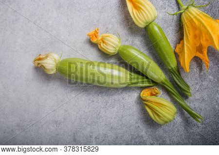 Zucchini And Zucchini Flower On Concrte  Background. Organic Food.