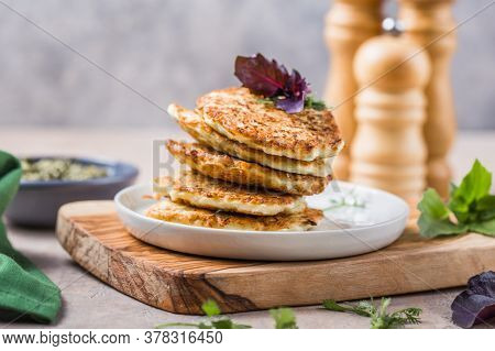 Vegetarian Zucchini Fritters Or Pancakes Stack Topped With Sour Cream And Cilantro. Vegetable Pancak
