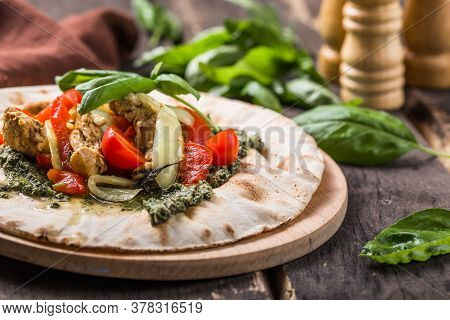 Fajitas With Tortilla Mix Pepper, Basil And Pesto On Wooden Board. Fajitas With Colored Pepper And O
