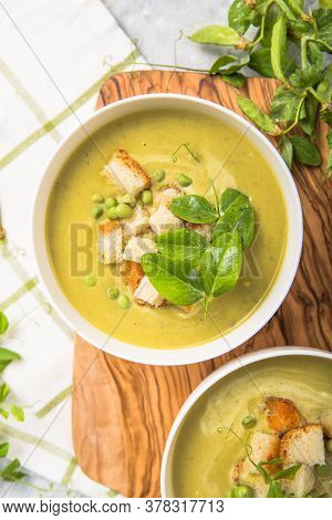 Pea Green Soup. Plate Of Summer Delicious Pea  Soup With Green Peas. Top View