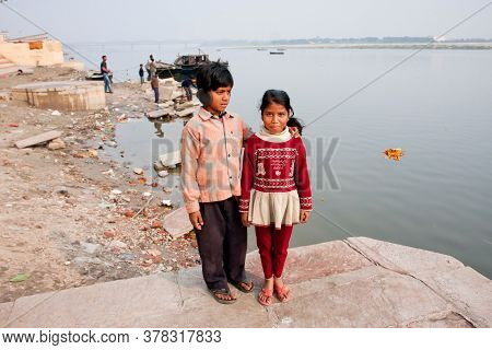 Varanasi, India: Portrait Of Poor Children Having Fun Near River Ganga, In Ancient Indian City On Ja