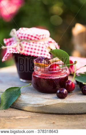 Homemade Cherry Jam With Fresh Cherries On The Wooden Table, Selective Focus And Rustic Style. Homem