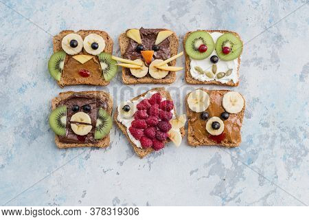 Funny Breakfast Toast For Kids Shaped As Cute Cat, Dog, Bear, Pig, Fish. Food Art Sandwich For Child