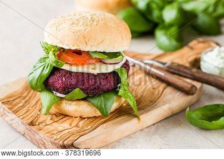 Veggie Beet  Burgers With Vegetables And  Greek Sauce. Healthy Food Concept. Veggie Beet Root Burger