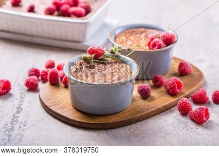 Rice Pudding. French Milk Rice Dessert With Raspberries. Rice Pudding.