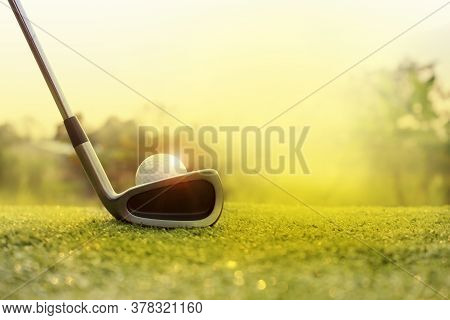 Golf Clubs And Golf Balls On A Green Lawn In A Beautiful Golf Course With Morning Sunshine.ready For