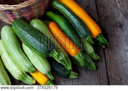 A Set Of Multi-colored Zucchini Yellow, Green, White, Orange On The Table Close-up. Food Background.