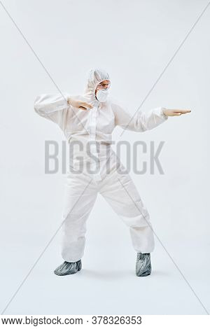 Full Lenght Portrait Of Happy Dancing Doctor In Ppe Suit On Blue Background. Emotions Concept