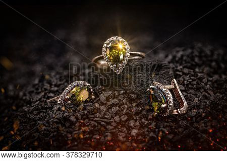 Jewelry Ring And Earrings Witht Big Yellow Gems On Black Coal Background