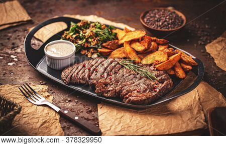 Grilled Sliced Steak Rib Eye With Pepper Sauce And Golden Fried Potatoes
