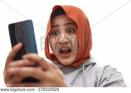 Shocked Worried Asian Muslim Woman Worried When Reading Bad News Text Message On Her Smart Phone Iso