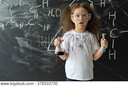 Little Girl Makes Experiments In Chemistry Lesson. Explosion During The Experiment.