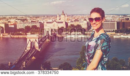 Happy Young Redhead Caucasian 20s Woman Toothy Smile At Budapest Panorama, Cinematic Style, Hungary