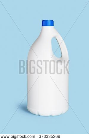White Plastic Container for Detergent on Blue Background
