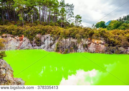 The unique geothermal area of Rotorua. Devil's Bath with bright green color of water. Volcanic Valley Waimangu, Wai-O-Tapu. New Zealand, North Island. Extreme, exotic and photo tourism concept