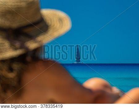 Woman at the beach in Lefkada Greece