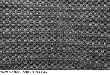 The Texture Of A Dense Fabric Embroidered In A Checkerboard Pattern.